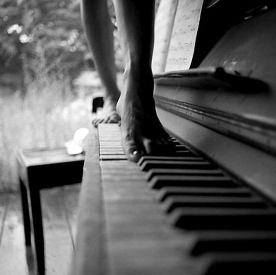 A beautiful photo - woman bare toes on the piano keys. Do you like the sepiatone?
