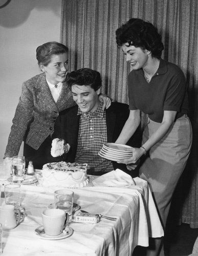 "Elvis with Dolores Hart and Valerie Allen at an ""Army Bond Farewell Party"" given by Hal Wallis during the making of KING CREOLE, 1958"