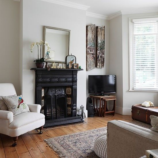 White living room with traditional fireplace and a very subtle paint color for walls...decorating | 25 Beautiful Homes | Housetohome.co.uk