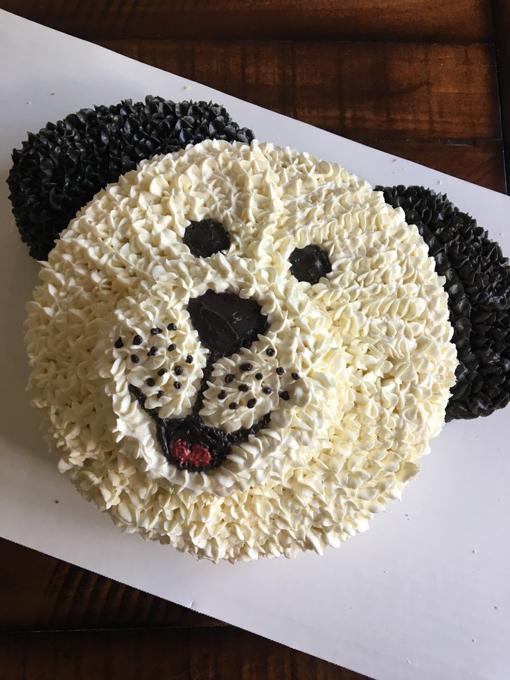 Black and white puppy cake for birthday party - use star tip to decorate - dog theme kid's birthday - puppy party - animal cake