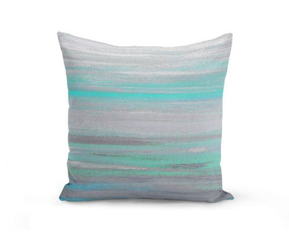 Modern Throw Pillow in a abstract print. The colors are blended shades of Grey, Mint, and Aqua. Individually cut and sewn, features a 2 sided print and is finished with a zipper for ease of care. SIZES: 16in. X 16in. 18in. X 18in. 20in. X 20in. 26in. X 26in. (euro size) 14in. X 20in.