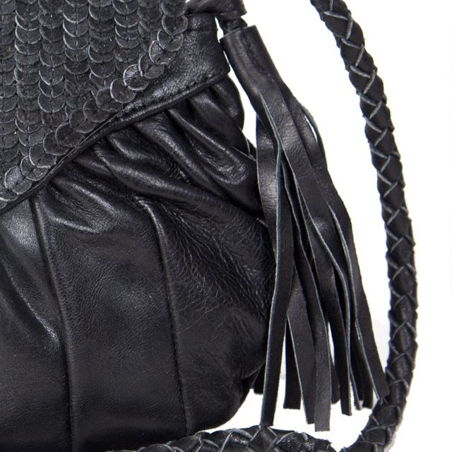 uma and leopold soft leather CLUTCH TASSEL BOLA. @ stores and online shop: http://umaandleopold.com/