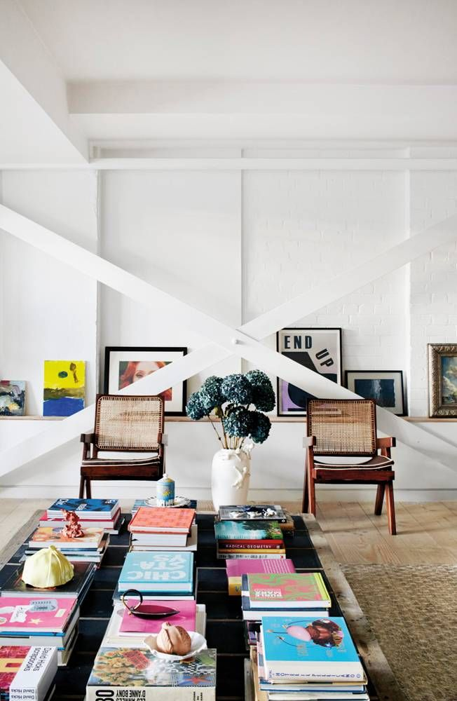 Exposed bricks, coffee table, A Modern London Flat Filled With Art and Major Style The Soho flat of retail visionary Alex Eagle brings together her smartly curated collections with a relaxed aesthetic.