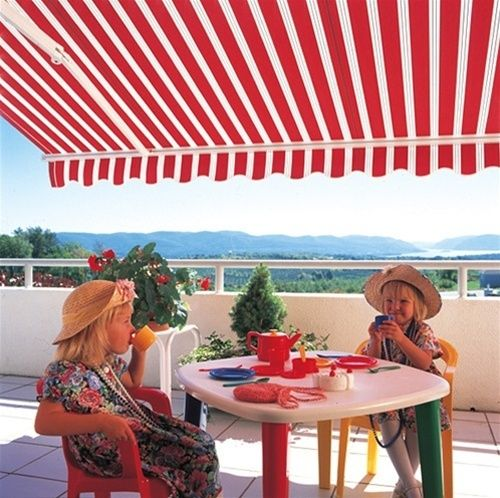 Solid Red Awning Is A Rooflike Shelter Of Extending Over Doorway From The Top
