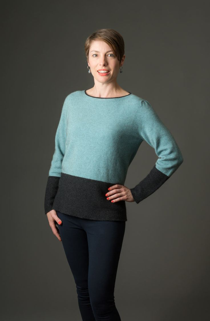 This new season knitwear design is a simple slightly widened boat neck women's possum merino sweater in topaz with contrast colour charcoal around the hips and lower arms. It is easy wearing for the weekend or smart casual for during the day at work. Made in New Zealand and available online at Gorgeous Creatures.