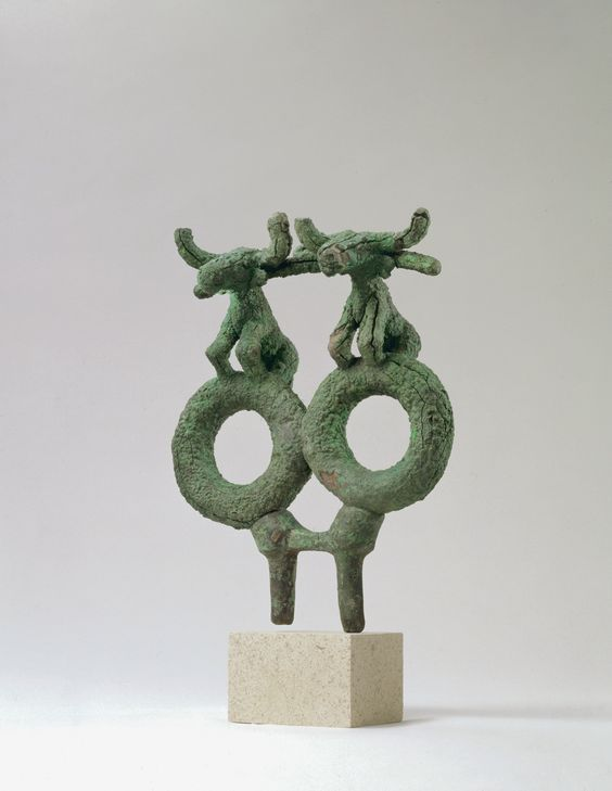 Anatolian bronze oxen on rings, 2300 B.C. The paired oxen illustrate with their two little rings on top of the yoke that real rings like those on which they stand were affixed to yokes and served as chariot rein-holders, 21 cm high. George Ortiz collection