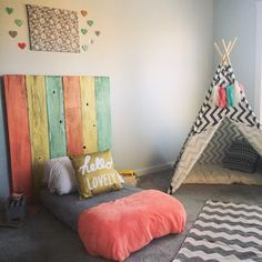Montessori toddler bedroom with a floor bed and teepee!