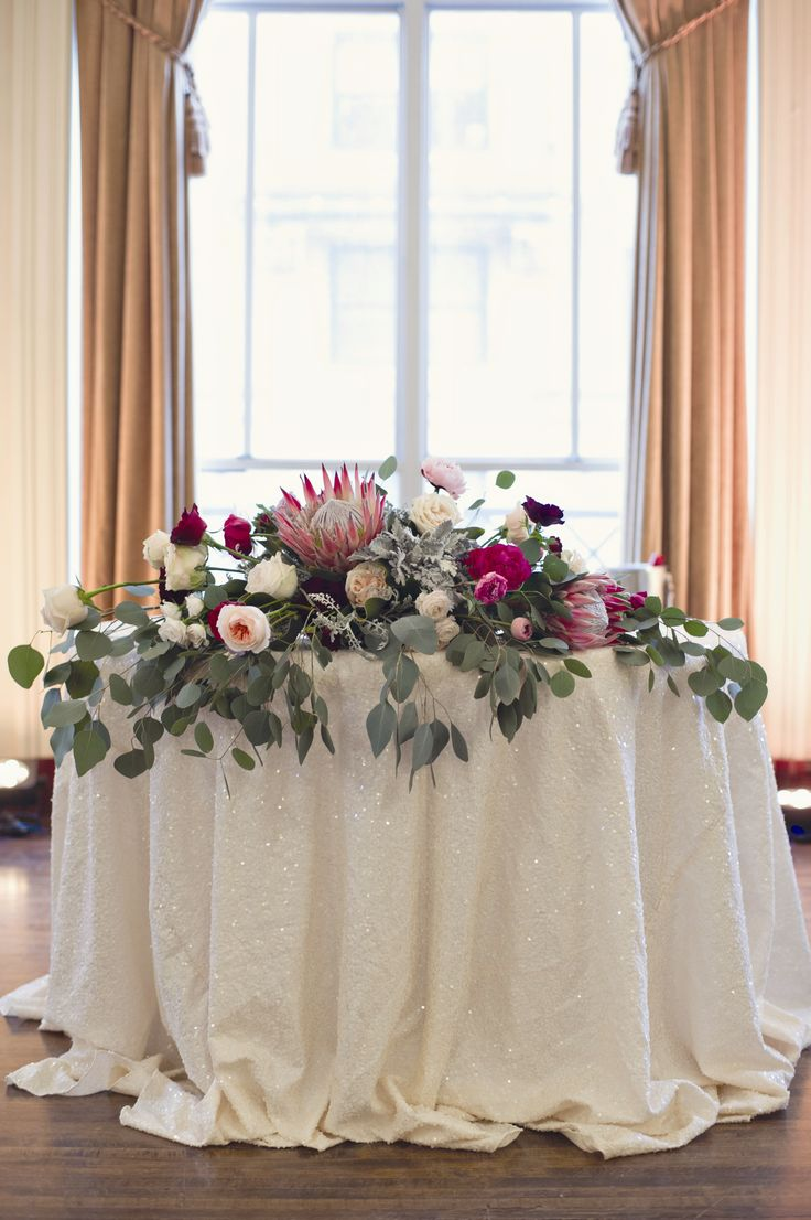 Lush protea centerpieces at a wedding at The Colony Club in Detroit, Michigan by Heather Saunders Photography. More wedding centerpieces http://www.theknot.com/weddings/photos/centerpieces