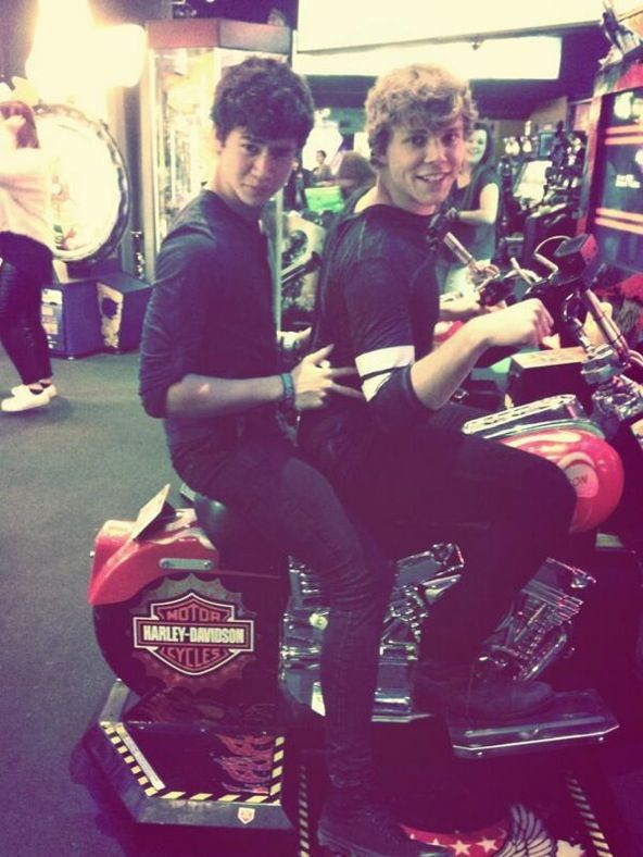 Yes Mom this is 2 members of a band that I spend my life fangirling over