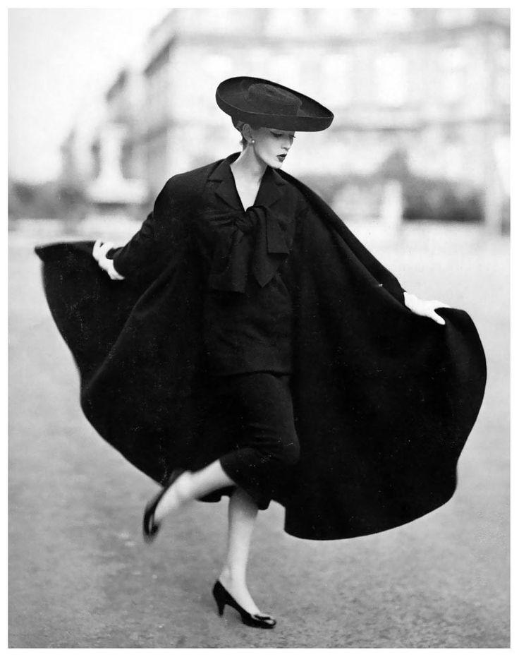 Dovima in cape ensemble by Lanvin-Castillo, photo by Avedon, Place Francois-Premier, Paris, August 1955