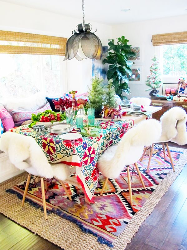 Such a fun, energetic design with the fabulous ethnic rug, suzani tablecloth & sheepskins on the chairs.