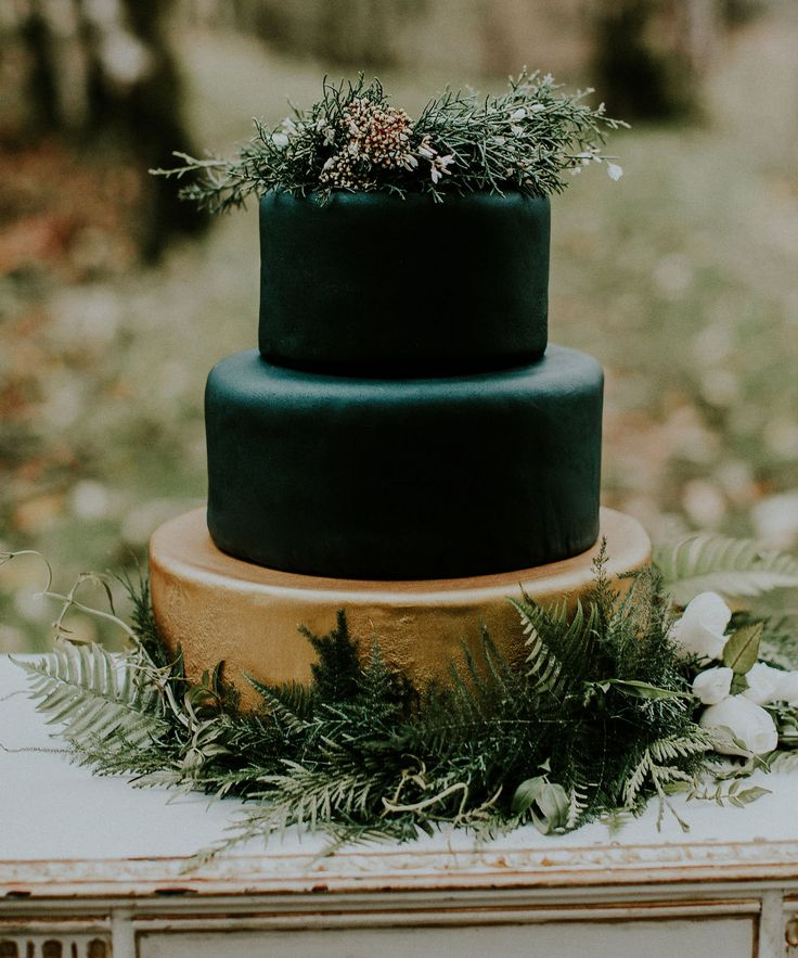 black gold forest fondant cake
