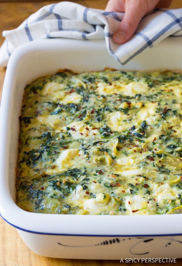 Spinach Artichoke Egg Casserole - A tempting savory breakfast casserole recipe loaded with vegetables and cheese. Ricotta, parmesan and white cheddar are th