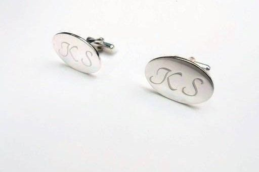 The oval cuff links made from silver 925 and the finish is lustrous .They are handmade and they have an ideal design which match with every style of menswear.  Every pair of cufflink is unique and the letters are written in calligraphy .Please note your initials or a date .