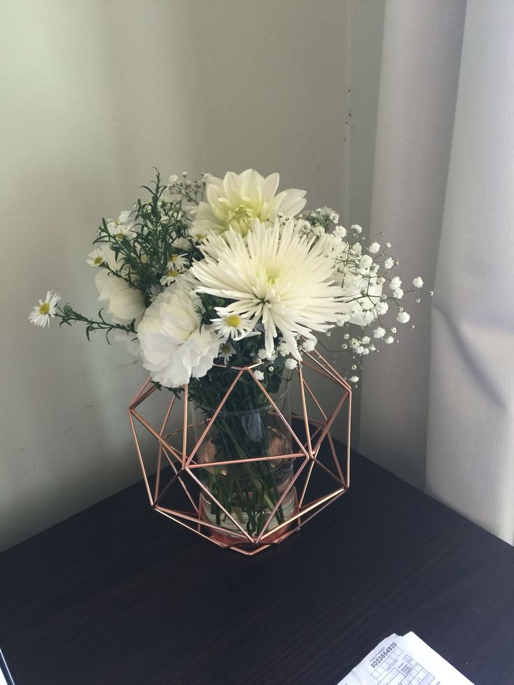 Copper Geometric candle holder from Kmart used as a vase.