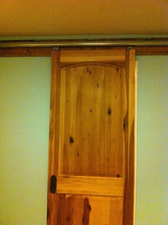 Door from habitat store, barn door rails from tractor supply, pine 1x6 Home Depot.  Less than $200.00 total and I have a beautiful knotty pine door between my kitchen and laundry!! Love it!!