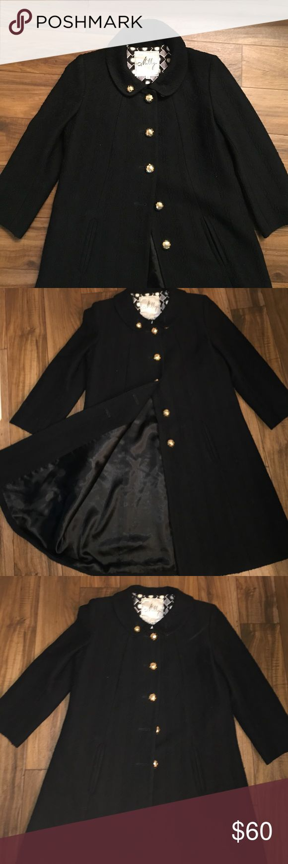Stylish black pea coat with detailed print! This is a mid-thigh length black pea coat that has only been worn a couple of times. It has a detailed print, pockets and gold buttons. Milly Jackets & Coats Pea Coats