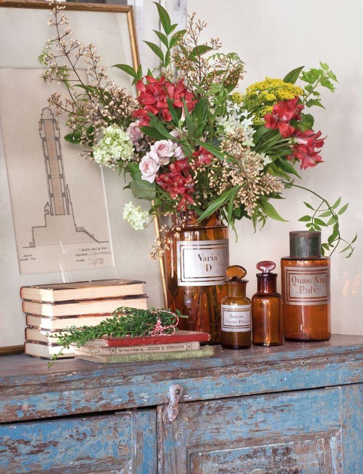 Ana Rosa ~ chippy dresser, books, jars with flowers