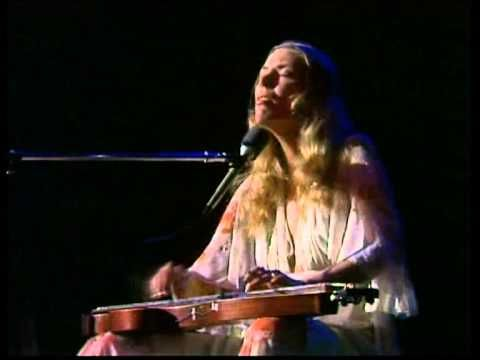"Joni Mitchell - A Case of You (live 1974) - YouTube Beautiful!  One of my favorites.  ""I could drink a case of you and I would still be on my feet."""