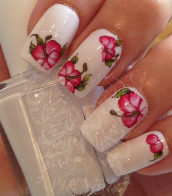 Pink Flower Nail Art Nail Water Decals Transfers Wraps. 20 Water Decals Use: 1-Trim,clean then paint your nails with the color you want. 2- cut out the pattern and plunge it into water for 10 - 20 sec