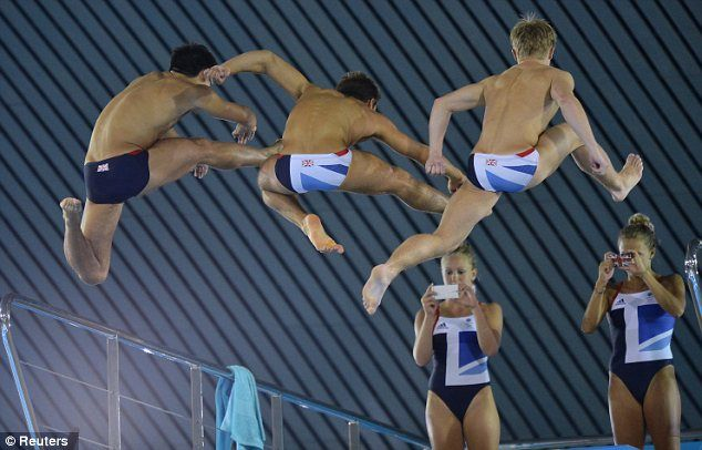 Divers (from left) Chris Mears, Tom Daley and Jack Laugher jump off the board and pose for Sarah Barrow and Tonia Couch