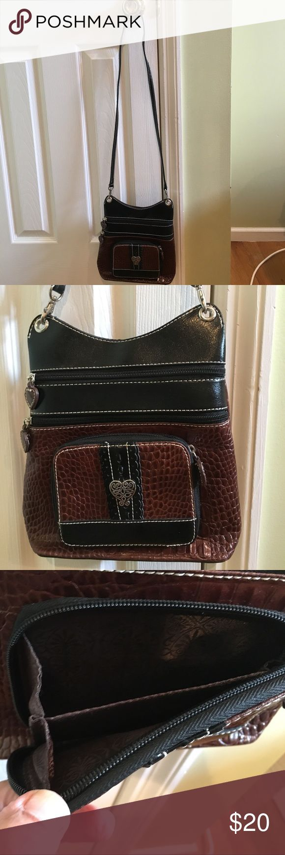 Cute crossbody black and brown handbag. Cute crossbody bag with 3 Zipper compartments. Top compartment is small. The 3 other zipper compartments are larger     Front  can be used as a wallet. Bags Crossbody Bags