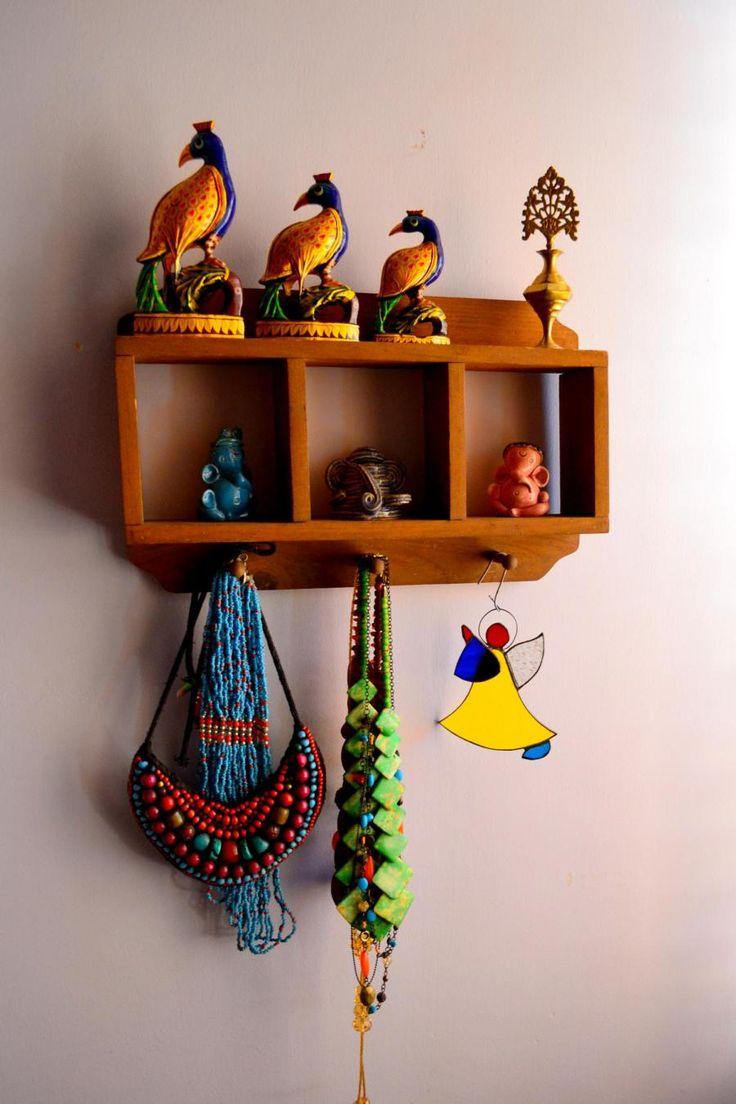 34 best from house to home images on pinterest indian interiors a small wooden wall shelf that has three ceramic ganeshas and also used as jewelry amipublicfo Gallery