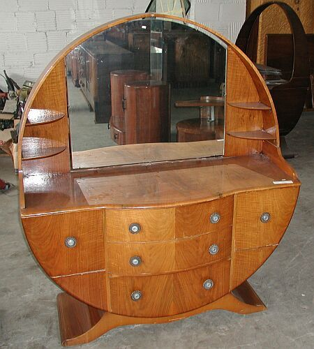 Bad photo aside, this is a really neat-looking art deco vanity. I could really use a vanity to hold all of my stuff!