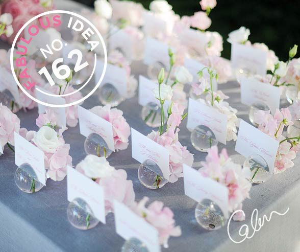 Glass bubble escort card holders filled with fresh flowers are a completely fabulous way to seat your guests.