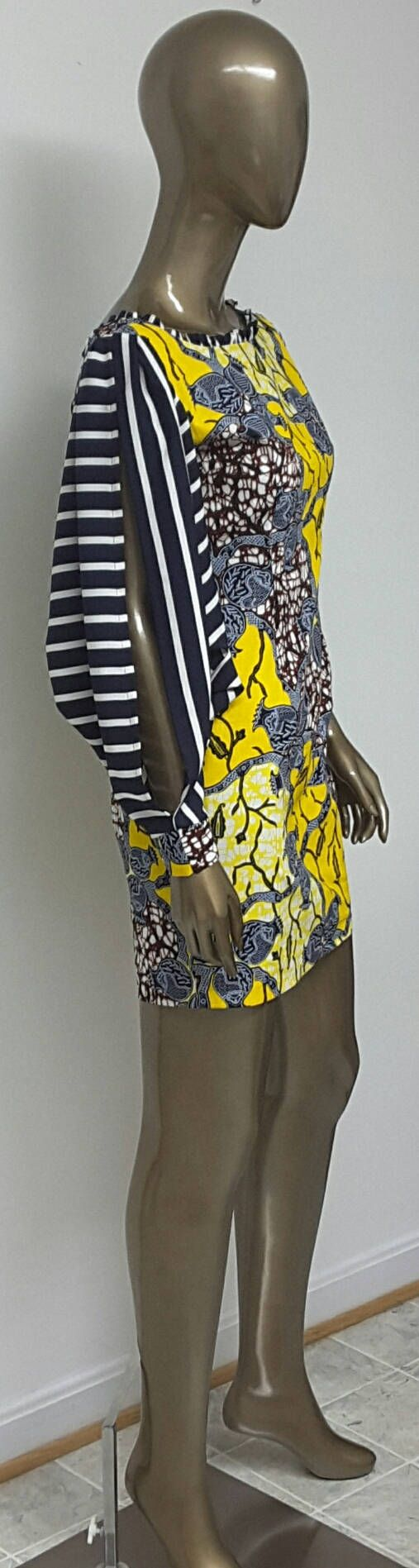 This is a beautiful fitted African Print mini dress with chiffon Slitted bubble sleeves, Scooped low back. The sleeves are dress unlined and very airy. Beautiful dress for a night out or any occassion. Dress length between 32 and 36 inches.  The sleeves can be done in white and navy as well. Select color when you order.    INCLUDED: • One dress DETAILS: • African Print • Care Instructions: Cold wash. Press  DRESS SIZES * US 2 – Bust 33 - Waist 24 inches - Hips 34-35 inches * US 4 -- Bust 34…