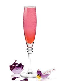 Holiday Mischief Maker Recipe. This pink and orange bubbly cocktail hopefully doesn't get you into to much Mischief. Here is our list of Christmas Drinks http://www.whattodrink.com/christmas/