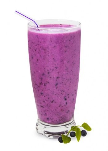 Blueberry Banana Smoothie Recipe: Running late? This low fat smoothie is a perfect on-the-go breakfast. Creamy fat-free yogurt with sweet blueberries and banana is a fresh start to any day.