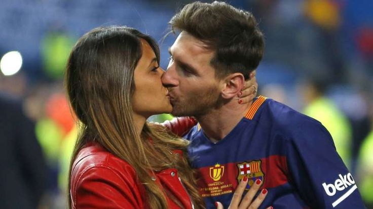 FILE - This is a Sunday, May 22, 2016 file photo of Barcelona's Lionel Messi, kisses his girlfriend Antonella Roccuzzo as they celebrate after winning the final of the Copa del Rey soccer match between FC Barcelona and Sevilla FC at the Vicente Calderon stadium in Madrid. Messi who will be the center of the attentions on Friday June 30, 2017 in his hometown of Rosario, Argentina,where he will be marrying 29-year-old Antonella Roccuzzo, his childhood friend and mother of his two children. (AP…