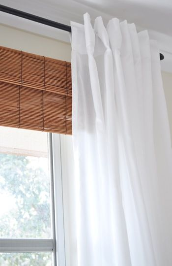 Like this look.  We had bamboo roman shades which I loved the look of, but rarely raised & lowered them b/c they were kind of a pain.  This gives the same look.