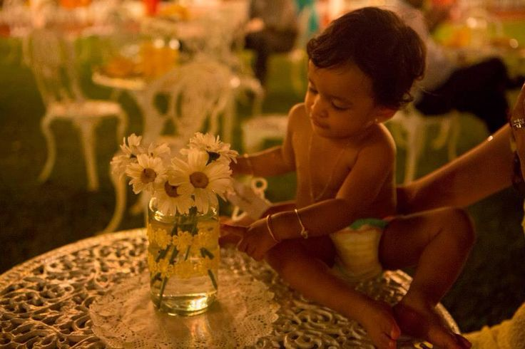 The centre pieces for the tables were made using jam jars which costed less than 20 srilankan rupees and I bought the ribbon from pettah and used glue to paste and got flowers each 10 srilankan rupees !