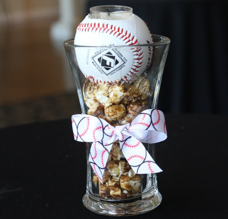 baseball wedding cocktail centerpiece..... I cut a hole in a baseball to fit a tealight.  I found coca-cola glass at the dollar store filled the bottom with crackerjacks and placed baseball on top