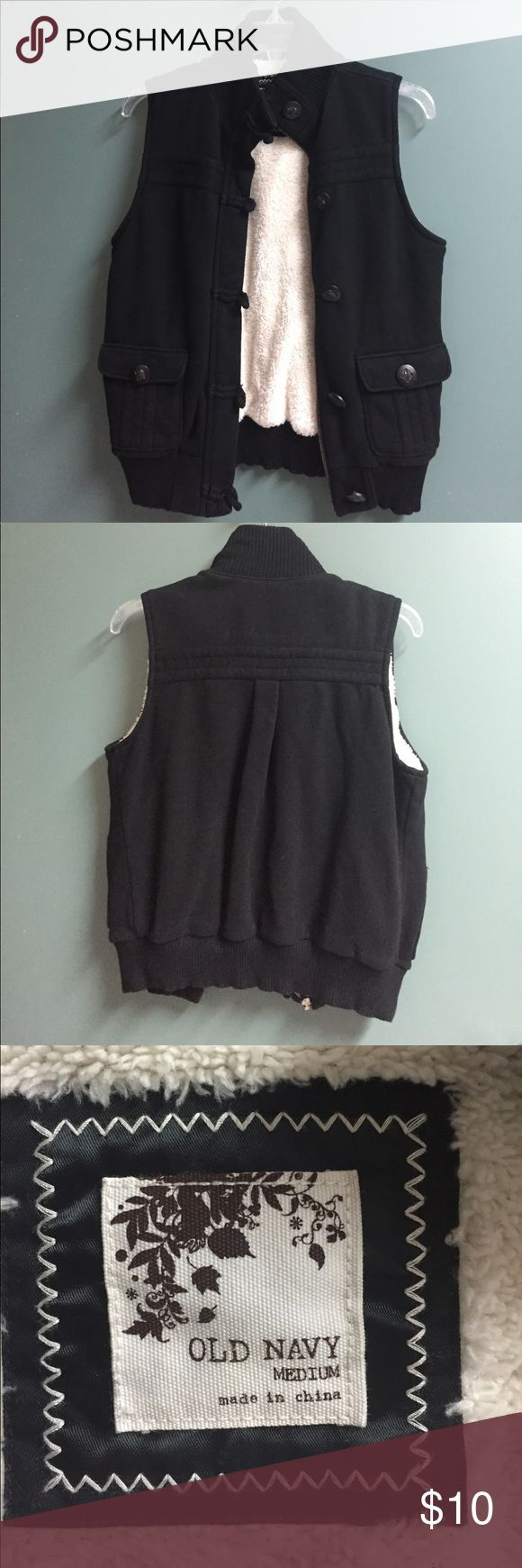 Old Navy Vest Lightly worn! This vest from Old Navy is very warm and cozy! Black outside with cream inside Old Navy Jackets & Coats Vests