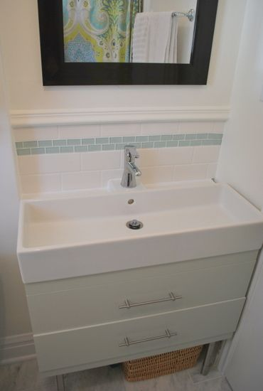 Great solution to a really small bathroom - this sink still has places to put things like soap without having to resort to a pedestal sink that sticks out into the space, and you get storage to boot! From thesweetestdigs.com