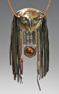 Bronze Mongolian Hunting Eagle : Resurrection Series  Materials:  Cast bronze eagle , Pipestone inlay, Carnelian eye, 22 kt gold bimetal eye, antique metal Akah belt link, Baltic Amber, fabricated bronze; bronze, copper and stone beads, leather fringe, waxed linen cord, 21-22 inch leather cord necklace.