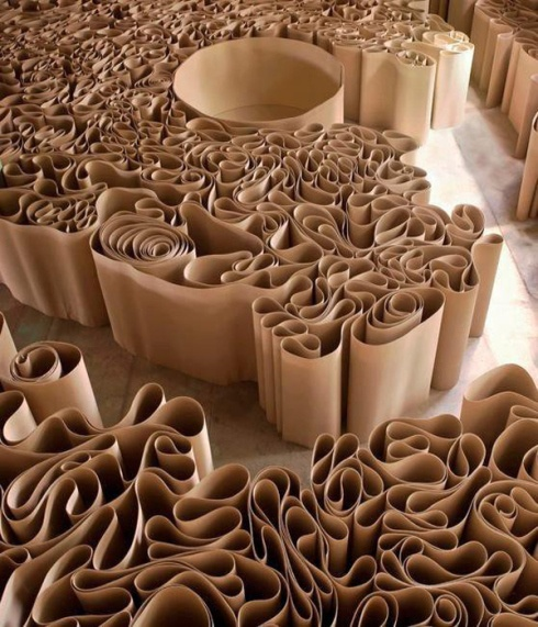Packing paper: used for volume. Here, it looks similar to Molo but we could use it fanned out, vertically. not for seating with would be a prototype on its own.