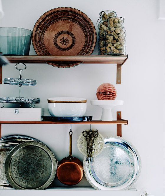 Mona customised her kitchen shelves with copper spray paint
