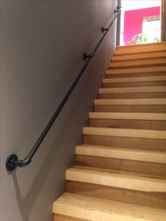 Steel Handrail 3/4 inch. Bought pipe and all hardware at Home Depot. Threaded pipe with manuel threader from local rental shop (12$ a day). Staircase is 3 in aspen.