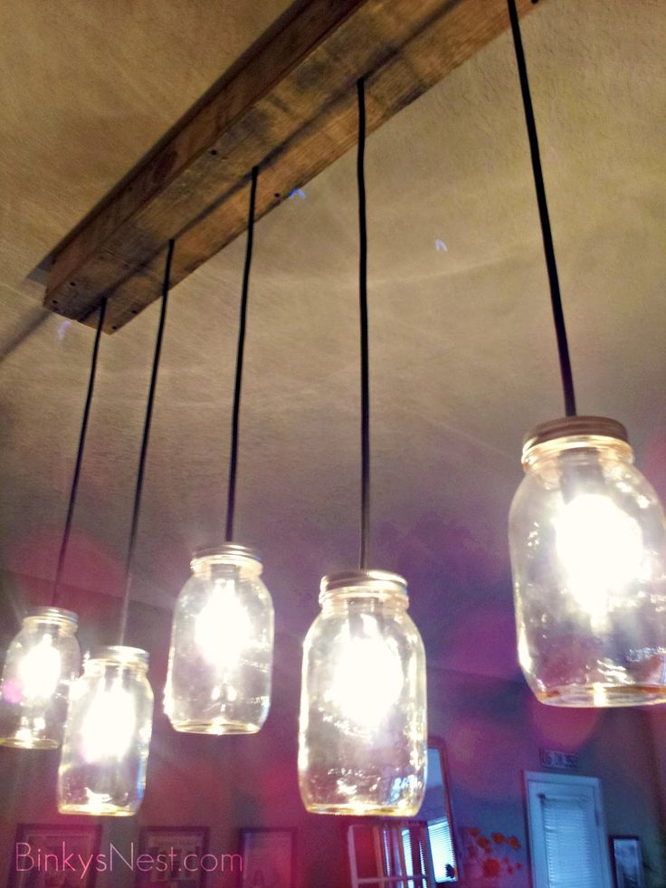 Mason Jar & Rustic Pallet Light Fixture Rachel and I have decided to do this but with the Starbucks glass jars after she's done drinking them.  They'll look like little glass milk bottles!