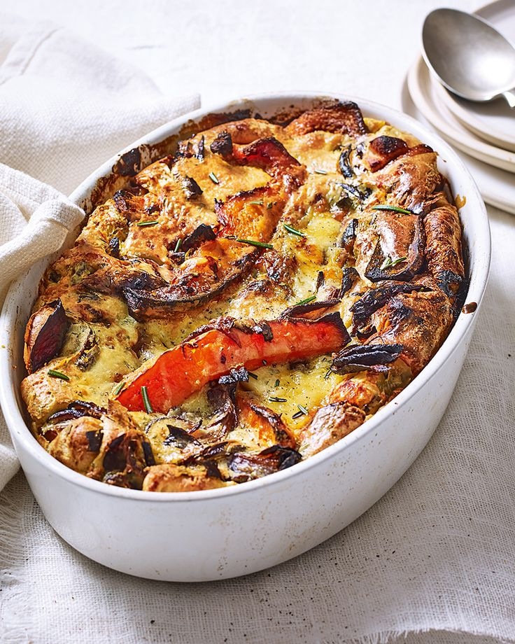 This vegetarian toad in the hole replaces sausages with caramelised roasted squash, before being dotted with stilton and baked until gooey and oozing.
