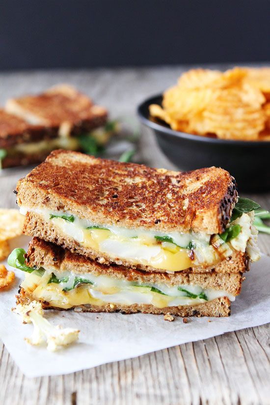 Roasted Cauliflower Grilled Cheese Recipe on twopeasandtheirpod.com Roasted cauliflower, arugula, lemon mustard aioli, and lots of cheese! This grilled cheese is SO good!