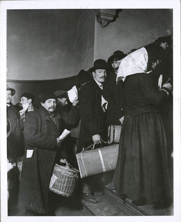 Climbing into America, immigrants at Ellis Island (1905, printed later). By Lewis Hine.