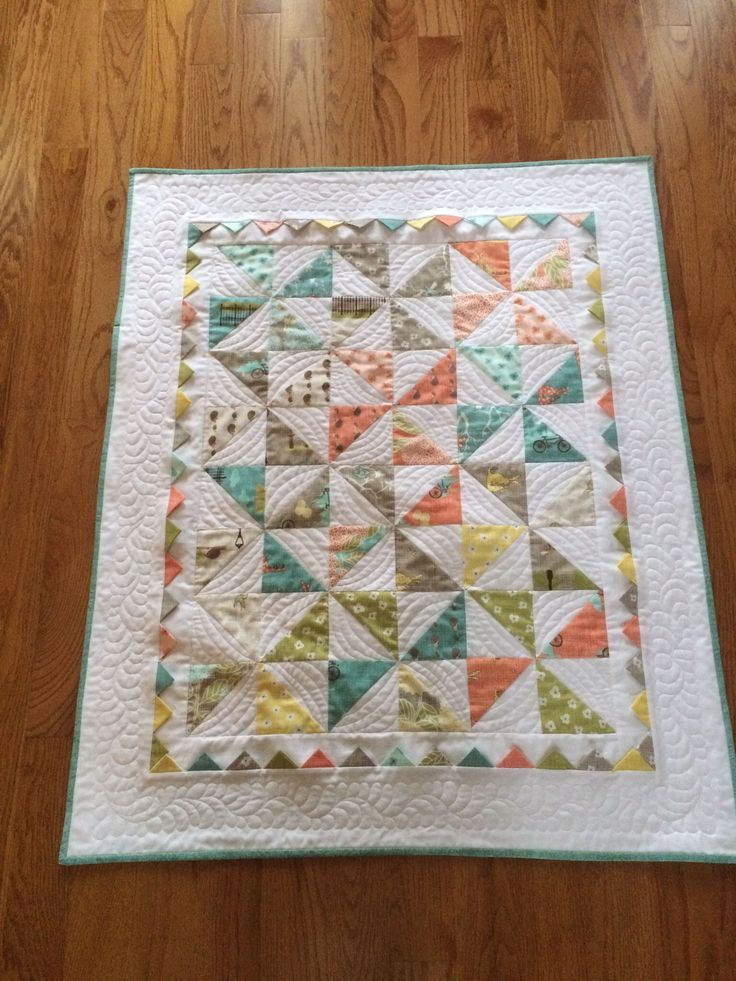 http://www.quiltingboard.com/pictures-f5/gender-neutral-pinwheels-prairie-points-t265216.html