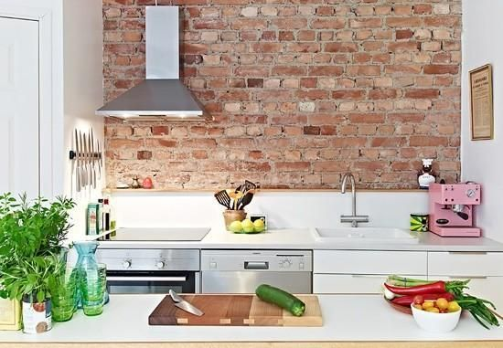white kitchen & brick wall