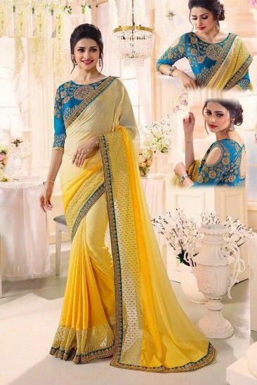 Shop Latest Designer Yellow georgette saree with blue banglori silk blouse - DMV15514 for women online  #Designersaree #yellow #georgette #parttywearsaree #blue #banglorisilk #blouse #womenfashion #shopping #online