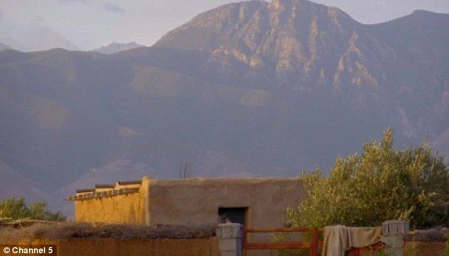 The mud hut has the stunning backdrop of the Atlas mountain region but Dina says she doesn...